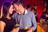 Cute couple drinking cocktails together