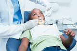Close up of boy having his teeth examined