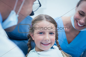 Close up portrait of girl having her teeth examined