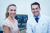 Portrait of smiling male dentist and woman