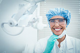Female dentist wearing surgical cap and safety glasses