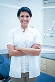 Smiling female dentist with arms crossed