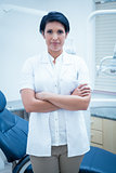 Confident female dentist with arms crossed