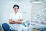 Female dentist with arms crossed