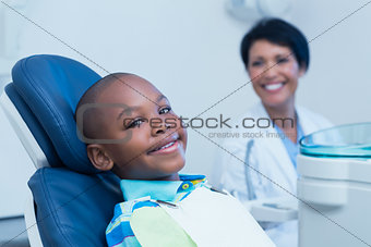 Smiling boy waiting for a dental exam