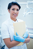 Female dentist holding reports