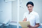 Female dentist reading reports