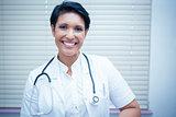 Confident smiling female dentist