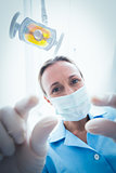 Female dentist in surgical mask