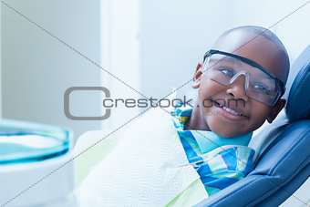 Smiling boy waiting for dental exam