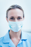 Female dentist wearing surgical mask