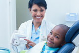 Dentist showing boy prosthesis teeth