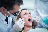 Woman having her teeth examined
