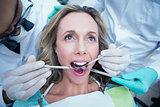 Close up of woman having her teeth examined