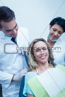 Portrait of dentist with assistant and female patient