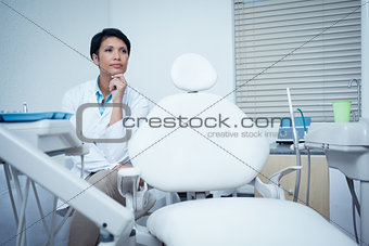 Thoughtful young female dentist