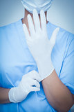 Female dentist wearing surgical glove