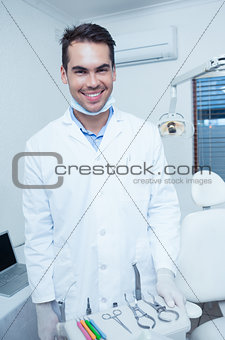 Portrait of smiling male dentist