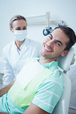 Smiling young man waiting for dental exam