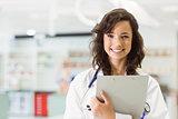 Pretty medical student smiling at camera