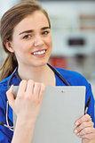 Young medical student smiling at camera