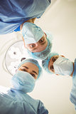 Young surgeons looking down at camera