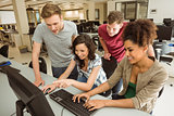 Classmates working together in the computer room