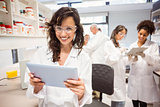 Science student holding tablet pc in lab