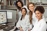 Science students smiling at camera