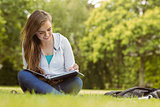 Smiling student sitting and reading book