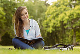Smiling student sitting and holding book