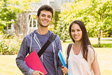 Smiling friends student standing with shoulder bag holding book