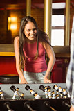 A brunette playing table football