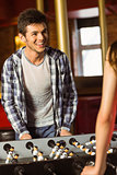 A brown hair playing table football