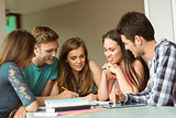 Smiling friends sitting studying together