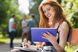 Pretty student studying outside on campus
