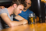 Caring friend comforting upset man