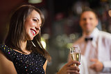 Pretty brunette smiling with champagne