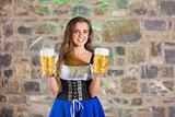 Smiling oktoberfest barmaid with beer