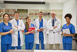 Medical professor smiling at camera with students