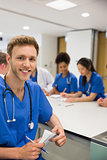Medical student smiling at the camera during class