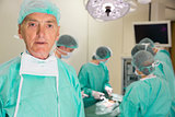Medical professor looking at camera during fake surgery