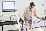 Man doing fitness test on exercise bike