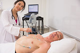 Medical student practicing on older man
