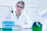 Science student using pipette in the lab