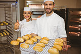 Team of bakers smiling at camera