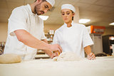 Team of bakers preparing dough