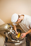 Baker using large mixer to mix dough