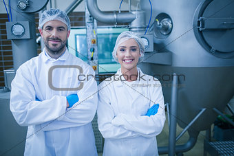 Food technicians smiling at camera