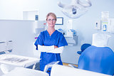 Dentist smiling at camera with arms crossed
